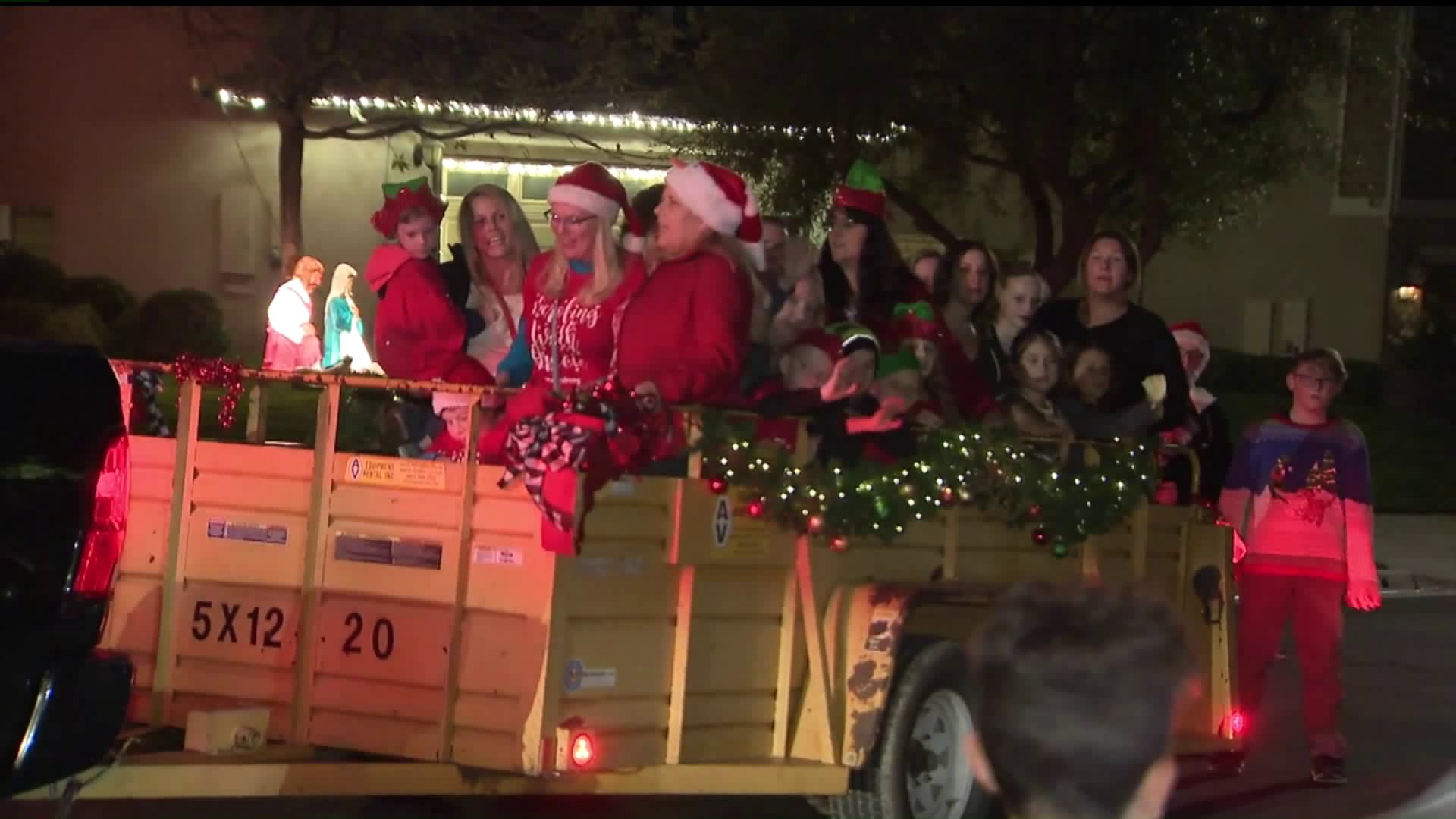Loved ones of Saugus High School shooting victim Gracie Anne Muehlberger gather to sing Christmas carols and collect food for the needy in her honor in Saugus on Dec. 12, 2019. (Credit: KTLA)