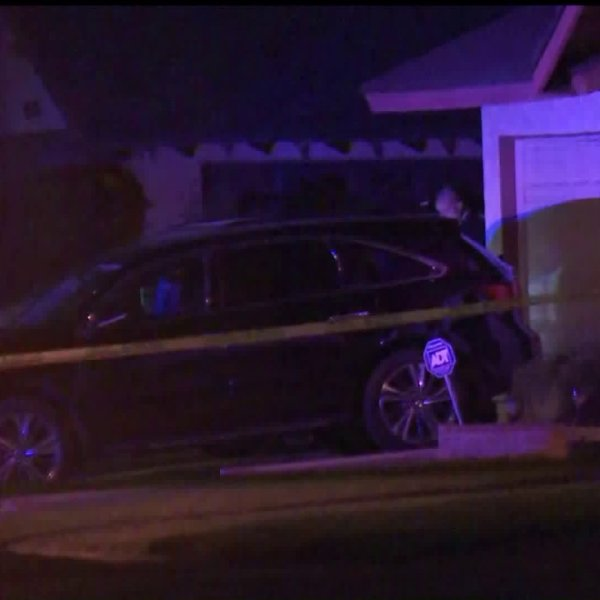 Caution tape is seen at a Carson home's driveway on Dec. 16, 2019 as officials investigate a deadly shooting. (Credit: KTLA)