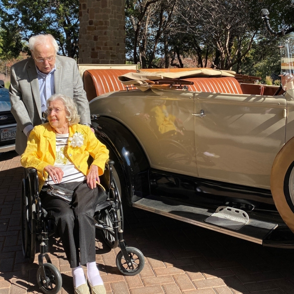 John Henderson, 106, picked up Charlotte Henderson, 105, in a 1920's Roadster to celebrate the major milestone. (Credit: Longhorn Village Senior Living Community)