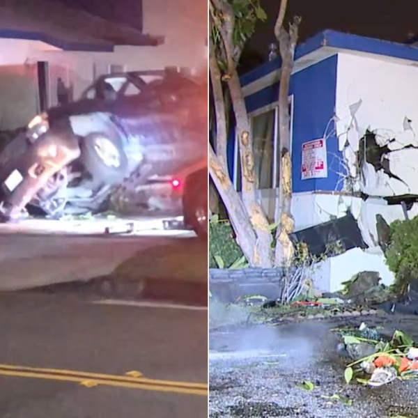 A vehicle plowed into an apartment building in Downey during a police pursuit on Dec. 30, 2019. (Credit: Loudlabs)