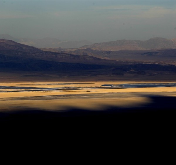 The setting sun casts shadows of Mt. Whitney across Owens Lake near Lone Pine in Inyo County. Climate change is forcing Los Angeles to consider banking some of the Sierra Nevada snowmelt under dry Owens Lake.(Credit: Brian van der Brug / Los Angeles Times)