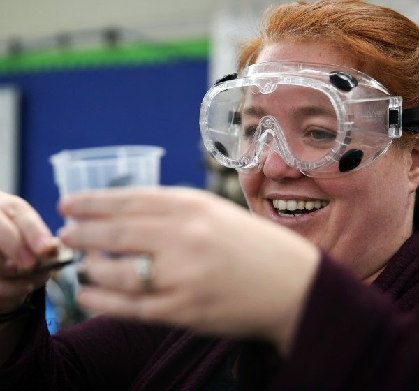 A teacher smiles after seeing a student's successful work on a ferrofluid project at Granada Hills Charter High School. (Credit: Dania Maxwell / Los Angeles Times)