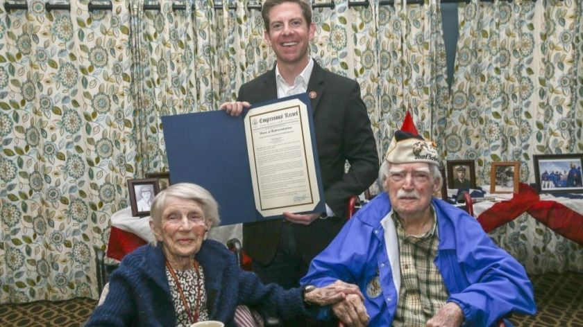 "U.S. Rep. Mike Levin holds the congressional record recognizing married Marine veterans LaVonne ""Bea"" Walsh, 95, and Joe Walsh, 100, on Joe's 100th birthday in March.(Credit: U.S. Marine Corps via Los Angeles Times)"