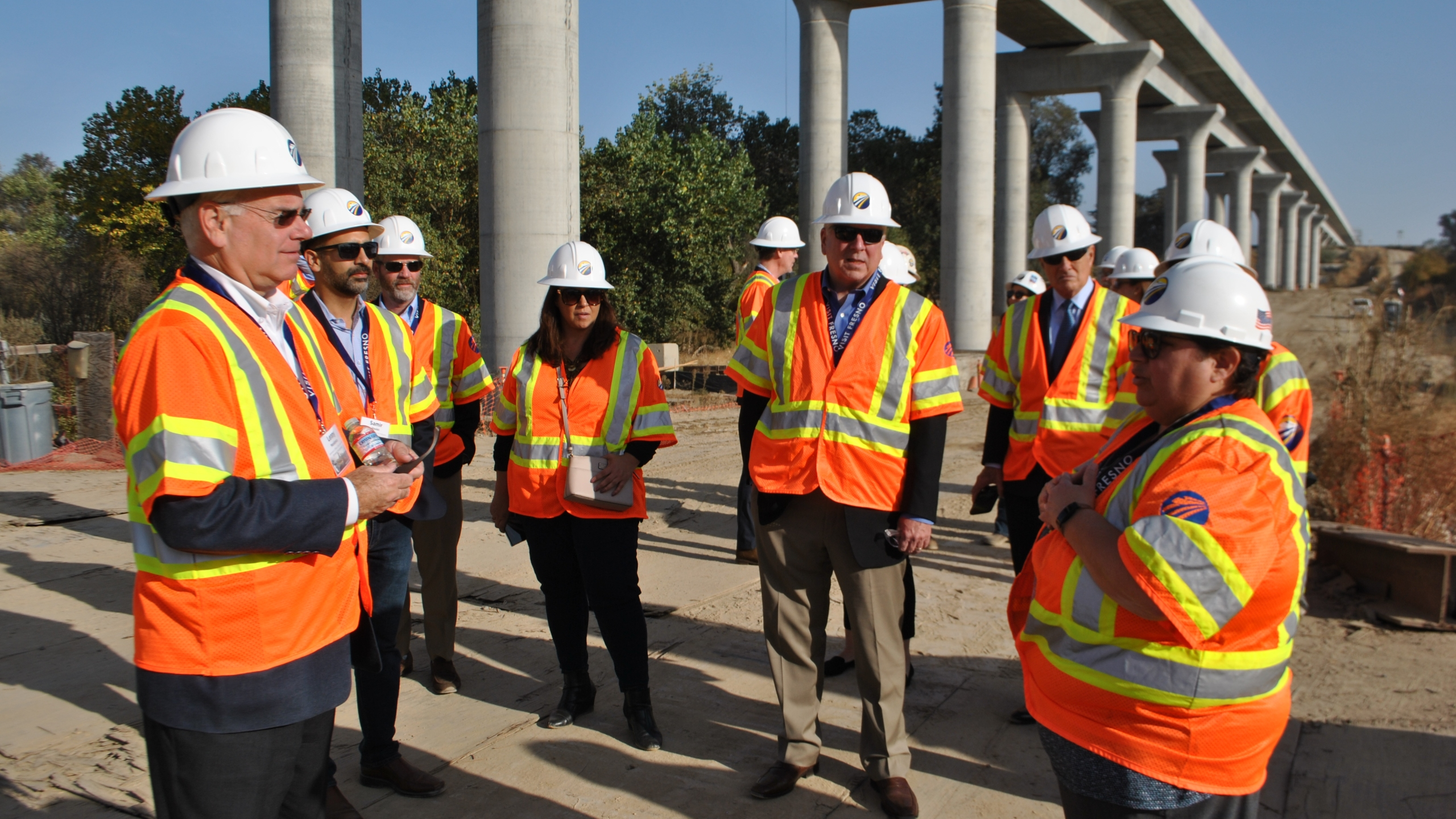 Officials lead a tour of several construction sites on California's high-speed rail project in Fresno on Nov. 6, 2019. (Credit: California High-Speed Rail Authority)