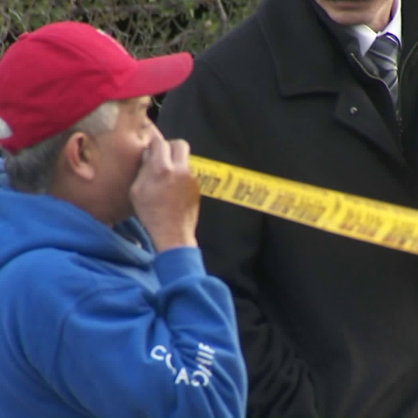 A man looks over the area where his brother was found fatally shot in East Hollywood on Dec. 21, 2019. (Credit: KTLA)
