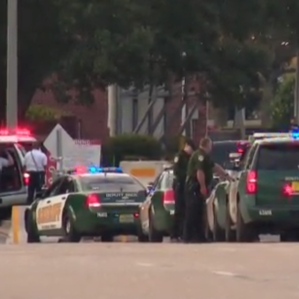 Authorities respond to a deadly shooting at Naval Air Station Pensacola on Dec. 6, 2019. (Credit: WEAR via CNN)