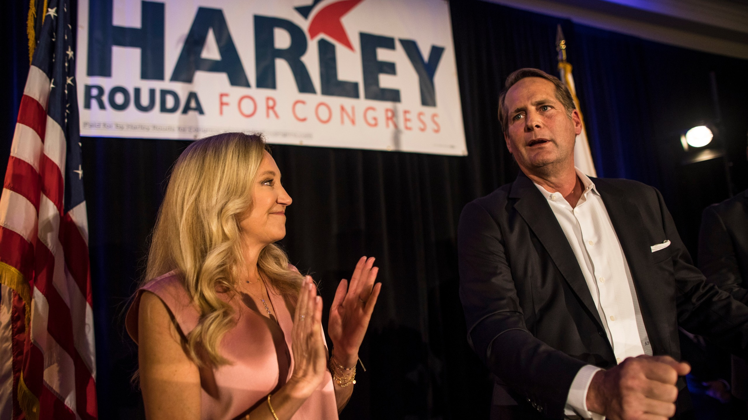 Harley Rouda, right, speaks to supporters with his family during their election day party on Nov. 6, 2018 in Newport Beach. (Credit: Barbara Davidson/Getty Images)