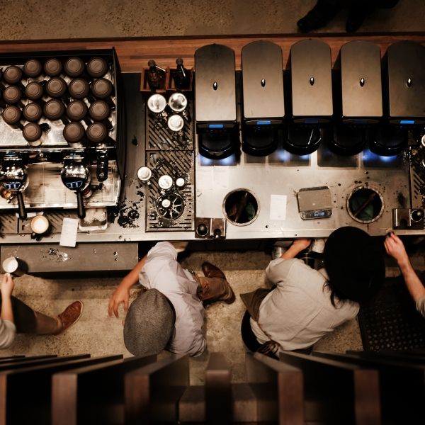 Employees serve customers at a newly opened Starbucks' Reserve Roasters in the Meatpacking District on Dec. 14, 2018, in New York City. (Credit: Spencer Platt/Getty Images)