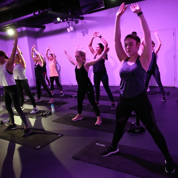 Guests participate in an exercise class during Women's Health National Workout Buddy Day on March 1, 2019 in New York City. (Credit: Monica Schipper/Getty Images)