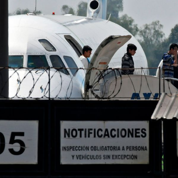Honduran migrants get off a plane as they arrive at the Ramon Villeda Morales airport in San Pedro Sula on April 11, 2019, after being deported from the U.S. (Credit: ORLANDO SIERRA/AFP via Getty Images)
