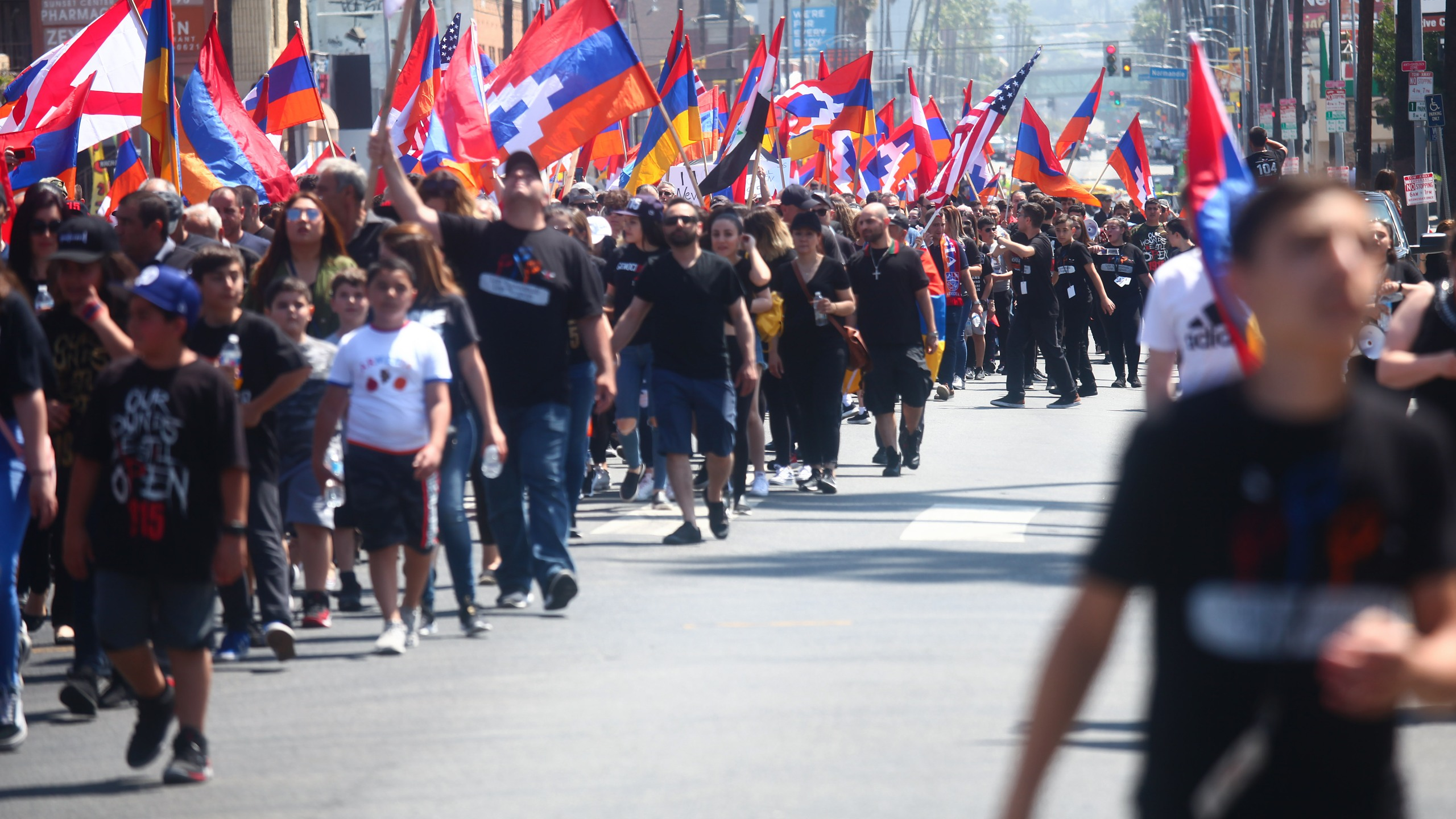 Armenians, Armenian descendants and supporters walk during a march and rally commemorating the 104th anniversary of the Armenian genocide on April 24, 2019, in Hollywood, California. Greater Los Angeles is home to one the world's largest Armenian communities outside of Armenia. (Credit: Mario Tama/Getty Images)