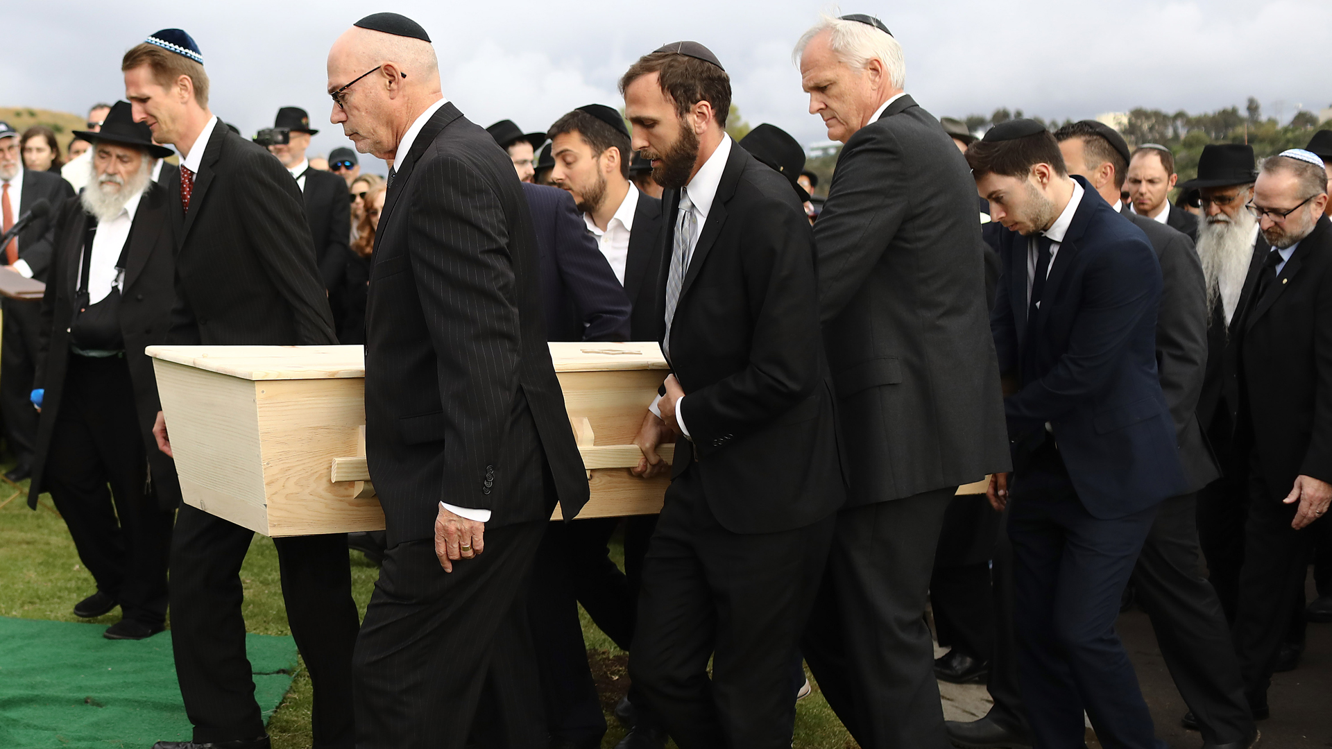 Pallbearers carry the casket of Chabad of Poway synagogue shooting victim Lori Gilbert Kaye during a graveside service on April 29, 2019, in San Diego, California. (Credit: Mario Tama/Getty Images)