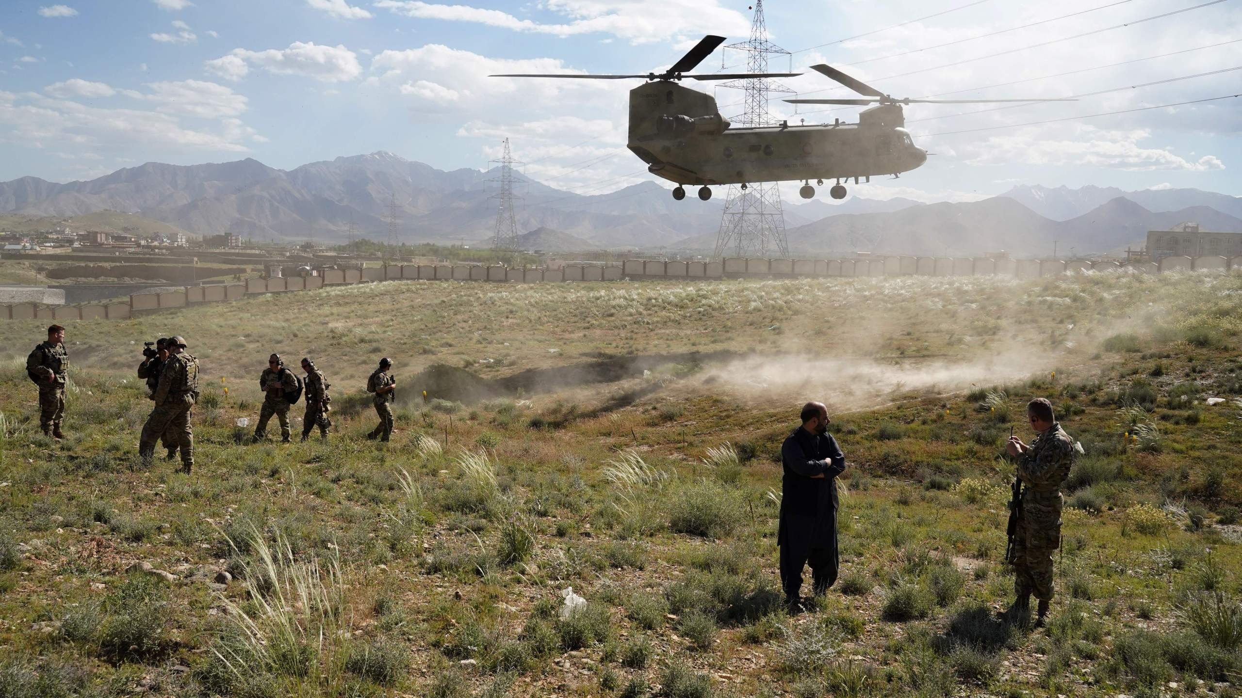 In this photo taken on June 6, 2019, a U.S. military Chinook helicopter lands on a field outside the governor's palace during a visit by the commander of U.S. and NATO forces in Afghanistan. (Credit: THOMAS WATKINS/AFP via Getty Images)