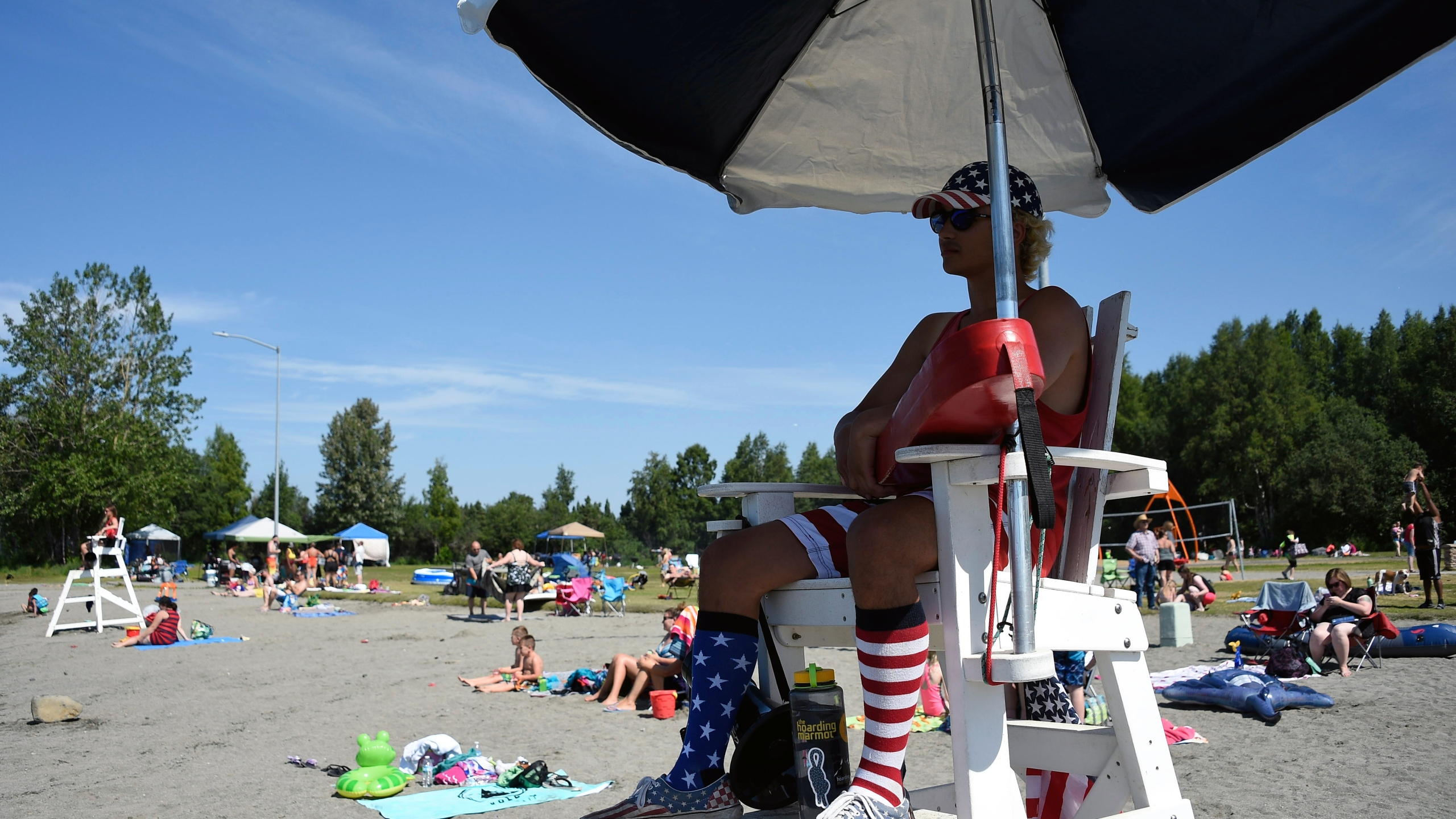 A lifeguard keeps watch at Jewel Lake on July 4, 2019 in Anchorage, Alaska. (Credit: Lance King/Getty Images)