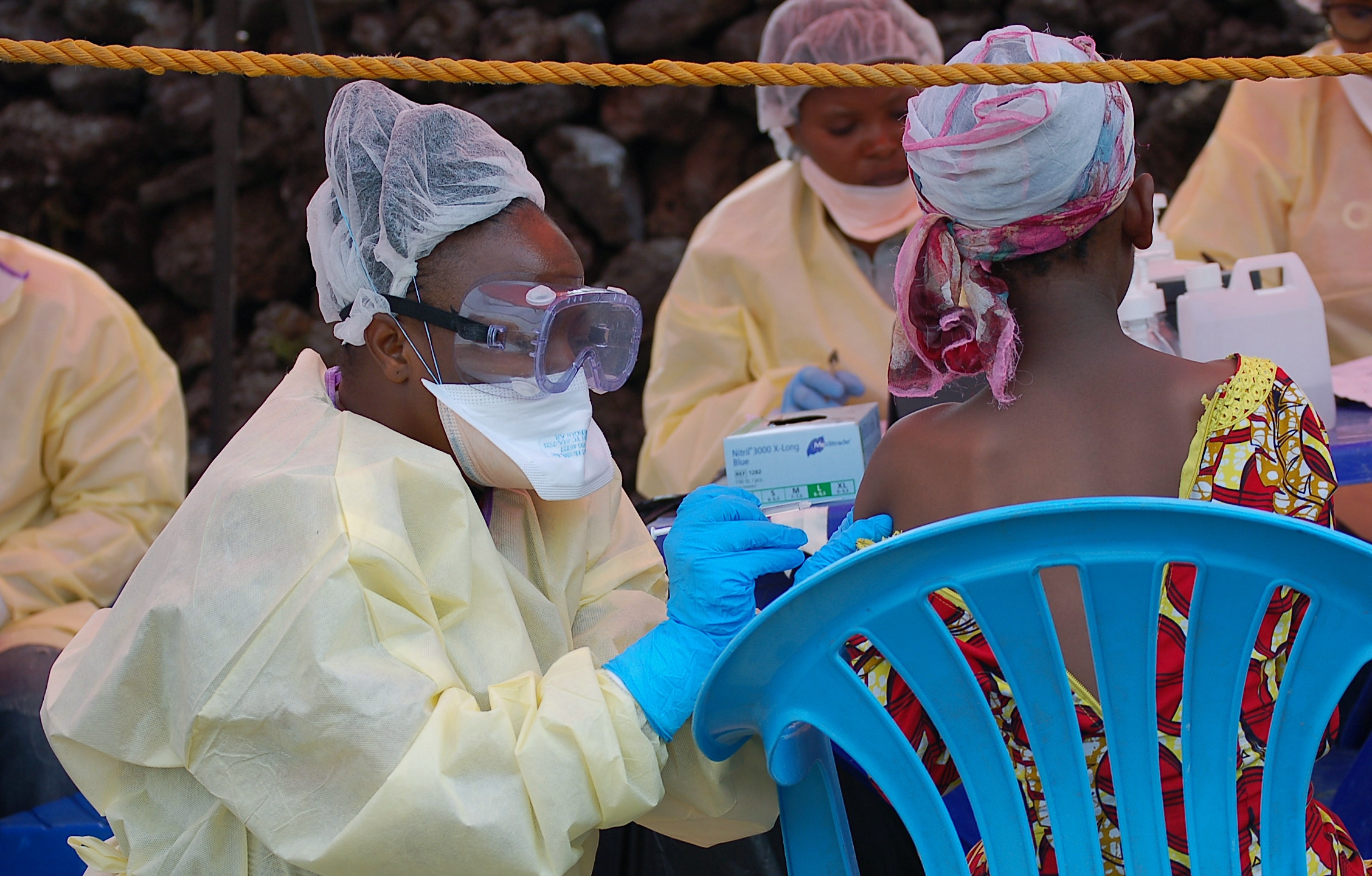 A girl receives a vaccine against Ebola from a nurse in Goma in the Democratic Republic of the Congo on Aug. 7, 2019. (Credit: Augustin Wamenya / AFP / Getty Images)