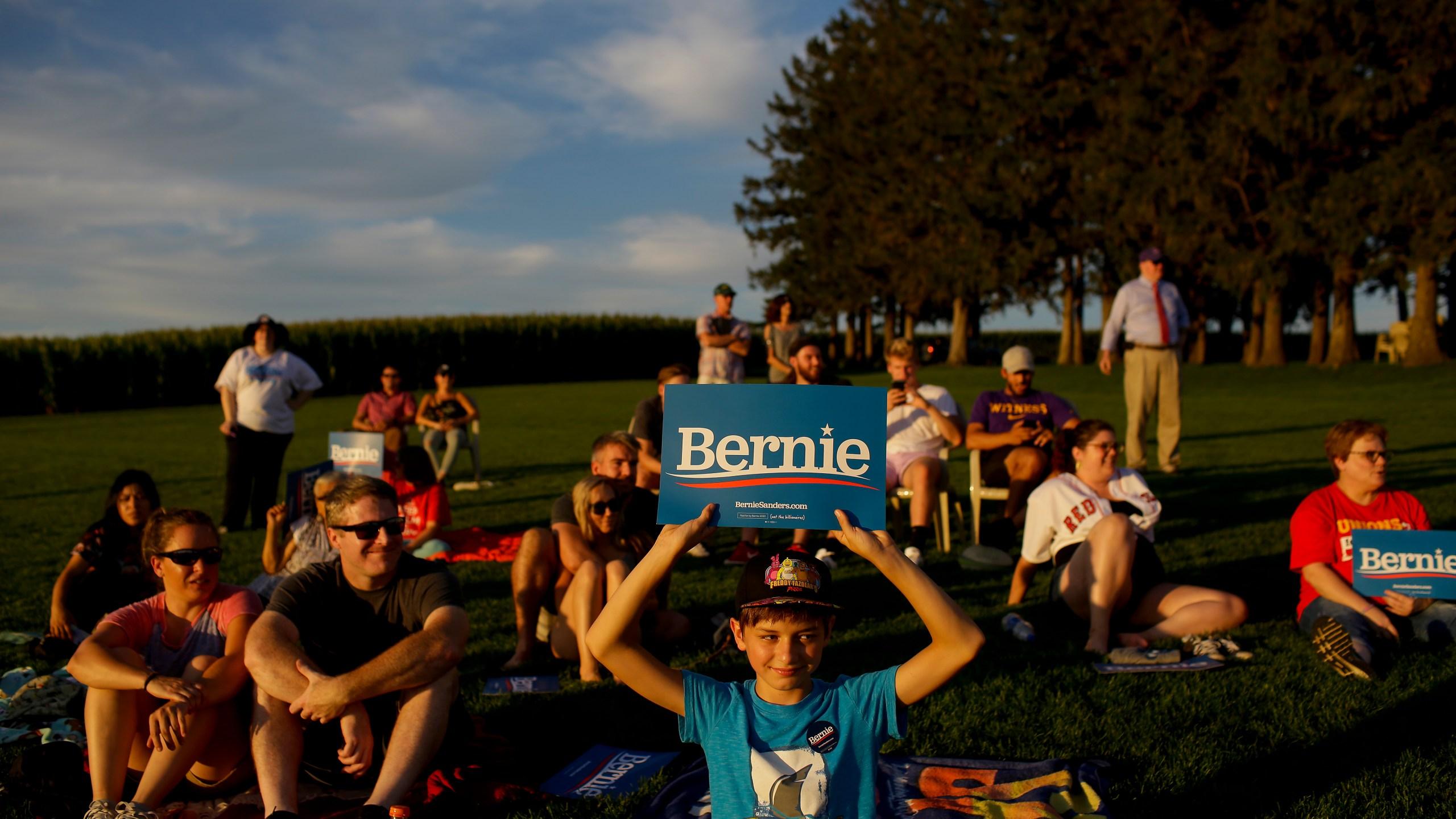People attend Democratic presidential candidate Sen. Bernie Sanders' baseball game on Aug. 19, 2019 (Credit: Joshua Lott/Getty)
