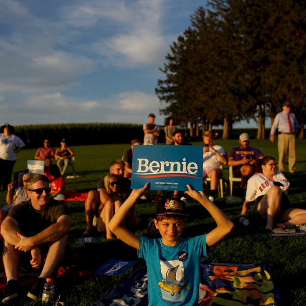 People attend Democratic presidential candidate Sen. Bernie Sanders' baseball game on Aug. 19, 2019 (Credit: Joshua Lott/Getty)