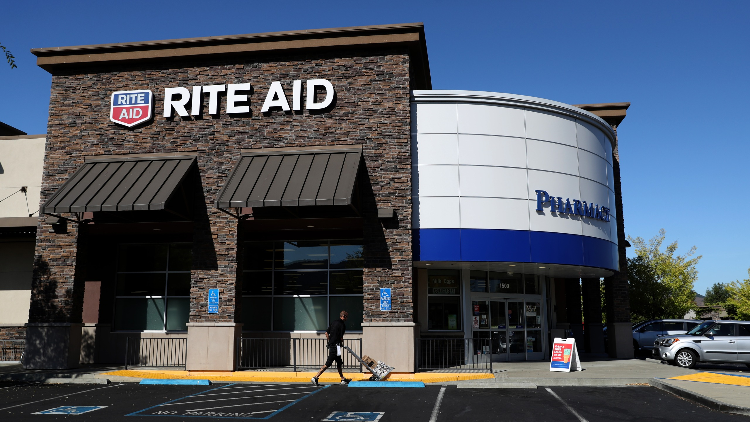 The Rite Aid logo is displayed on the exterior of a Rite Aid pharmacy on September 26, 2019 in San Rafael, California. (Credit: Justin Sullivan/Getty Images)
