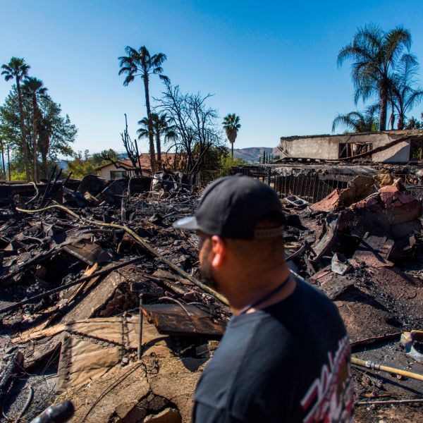 Matthew Valdivia looks at what is left of his home on Viento Way after it was destroyed by the Hillside Fire in San Bernardino, Oct. 31, 2019. (Credit: Apu Gomes / AFP / Getty Images)