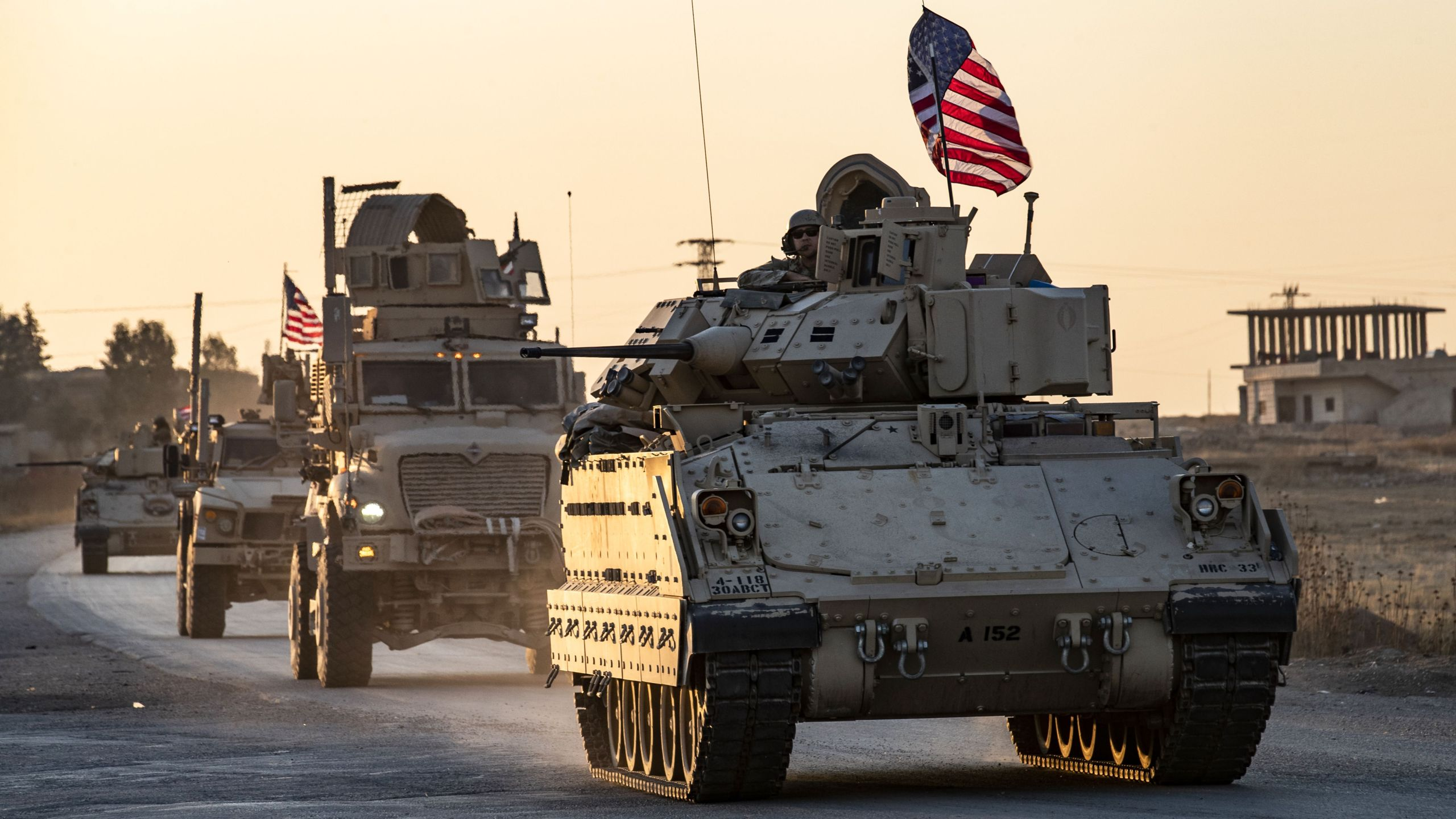 A convoy of U.S. military vehicles drives near the town of Tal Tamr in the northeastern Syrian Hasakeh province, on the border with Turkey, on Nov. 10, 2019. (Credit: Delil Souleiman / AFP / Getty Images)