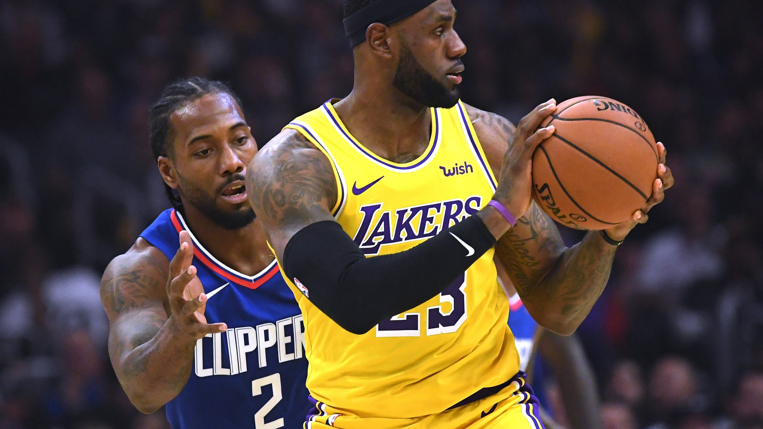 Kawhi Leonard and LeBron James play at Staples Center on Oct. 22, 2019. (Harry How/Getty Images)