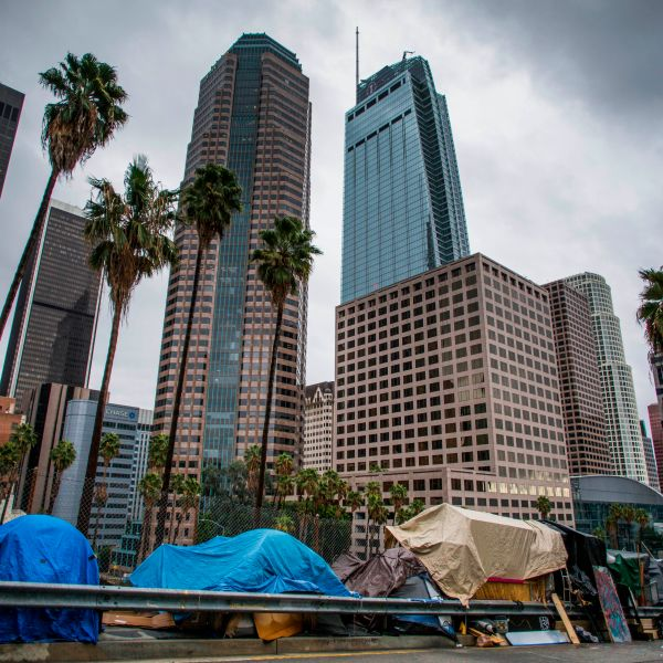 Tents line a freeway ramp in downtown Los Angeles on Thanksgiving Day, Nov. 28, 2019. (Credit: Apu Gomes / AFP / Getty Images)