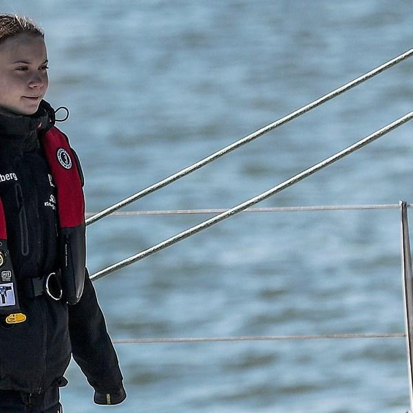 Swedish climate activist Greta Thunberg arrives at the Santo Amaro docks in Lisbon onboard the catamaran La Vagabonde, on Dec. 3, 2019.(Credit: CARLOS COSTA/AFP via Getty Images)