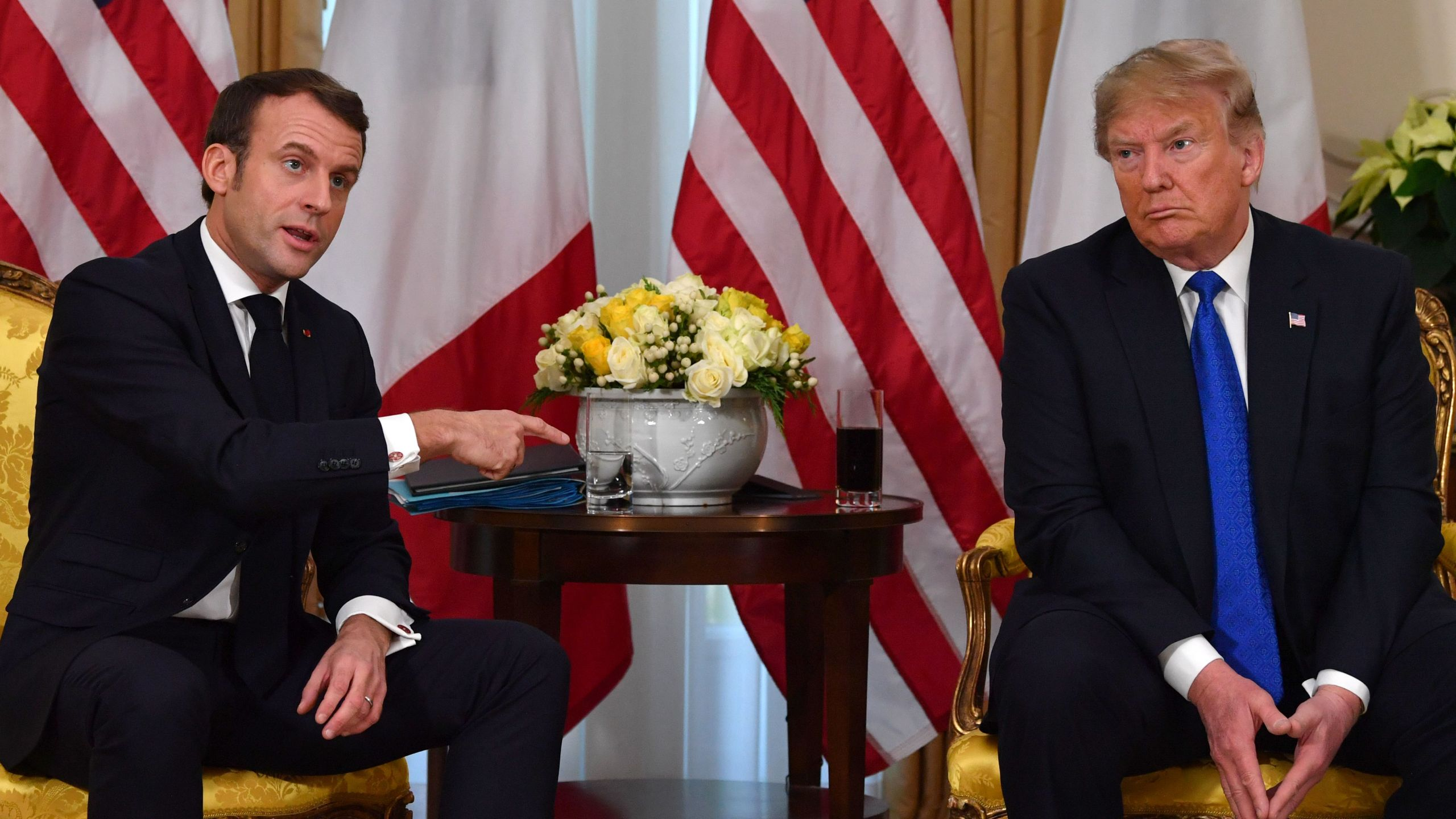 President Donald Trump, right, meets French President Emmanuel Macron at Winfield House, London on Dec. 3, 2019. (Credit: NICHOLAS KAMM/AFP via Getty Images)