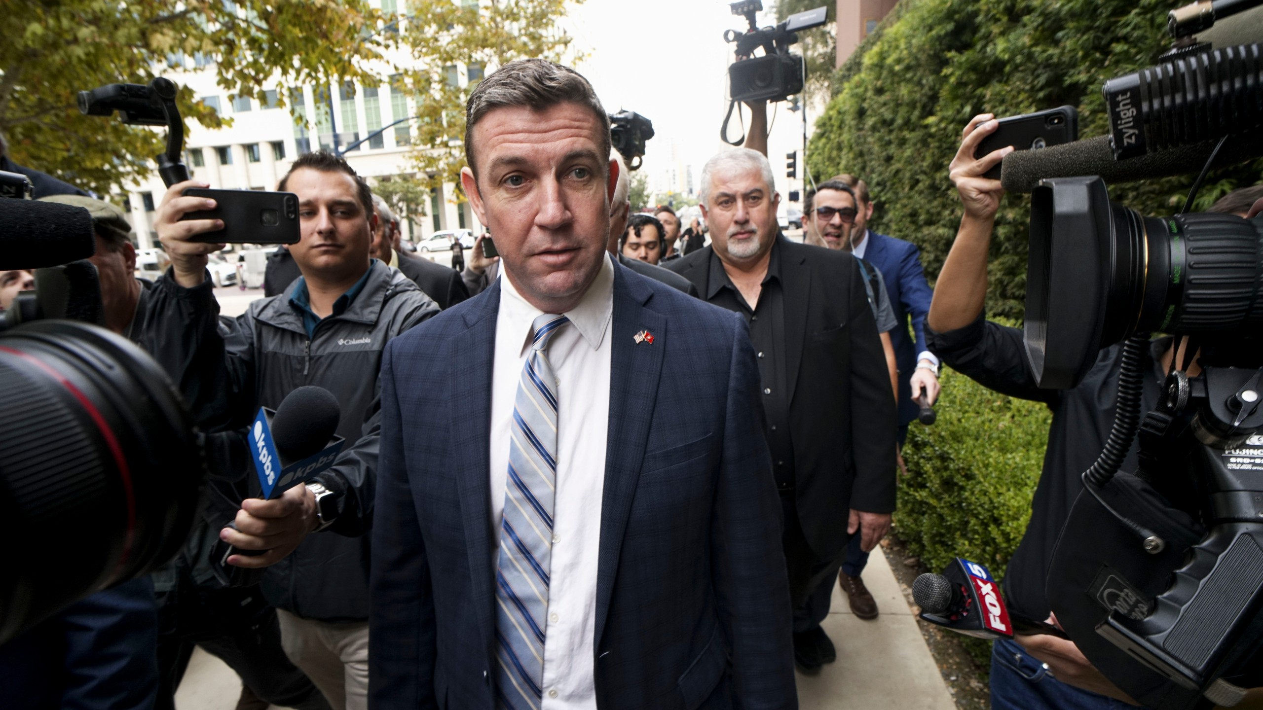 Rep. Duncan Hunter walks into a federal courthouse in San Diego on Dec. 3, 2019. (Credit: Sandy Huffaker / Getty Images)
