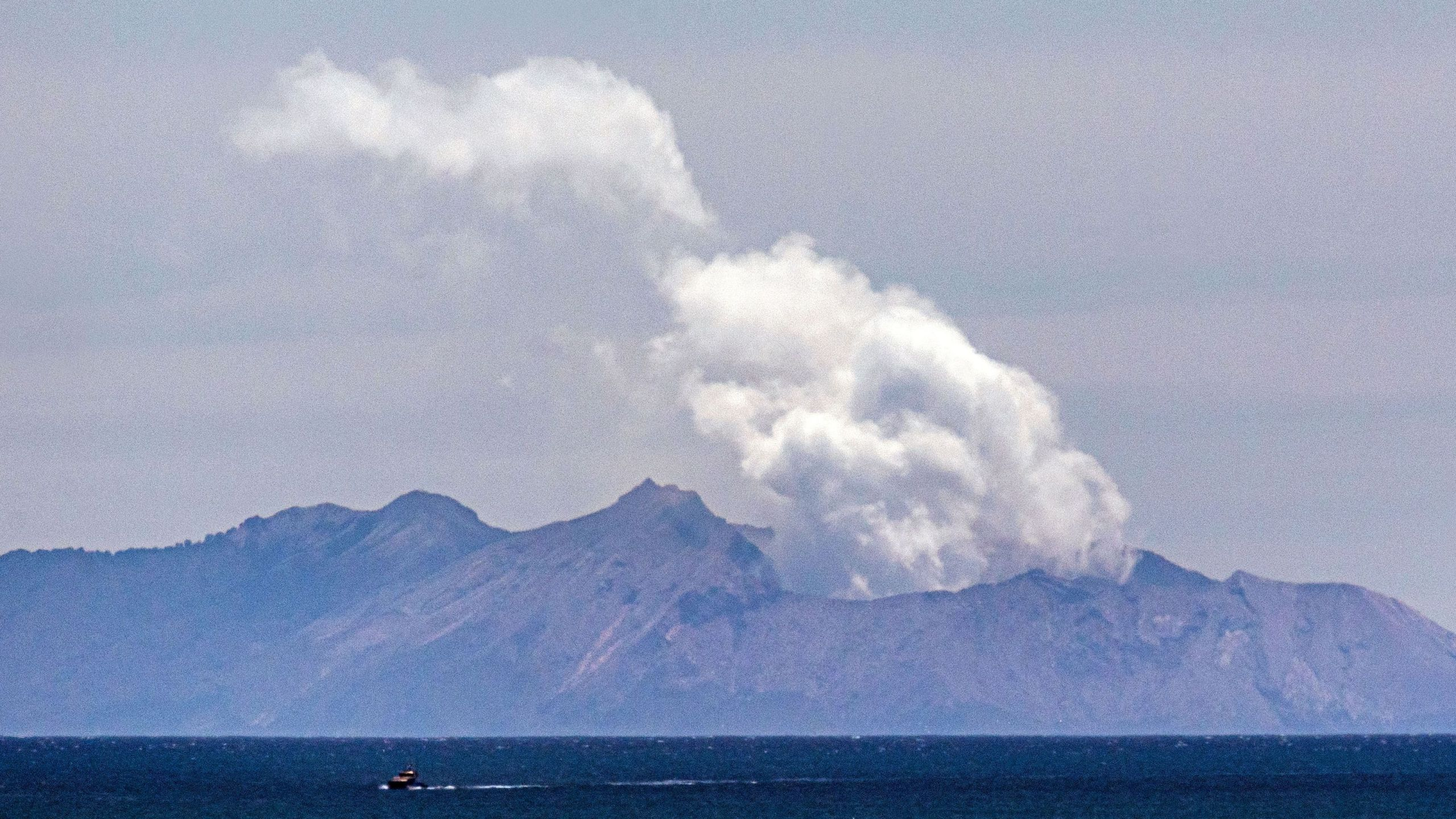 Steam rises from the White Island volcano following the Dec. 9 volcanic eruption in Whakatane on Dec. 11, 2019. (Credit: Marty Melville / AFP / Getty Images)