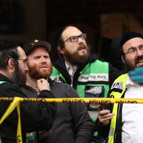 Recovery and clean-up crews work the scene in the aftermath of a mass shooting at the JC Kosher Supermarket on Dec. 11, 2019 in Jersey City, New Jersey. (Credit: Rick Loomis/Getty Images)