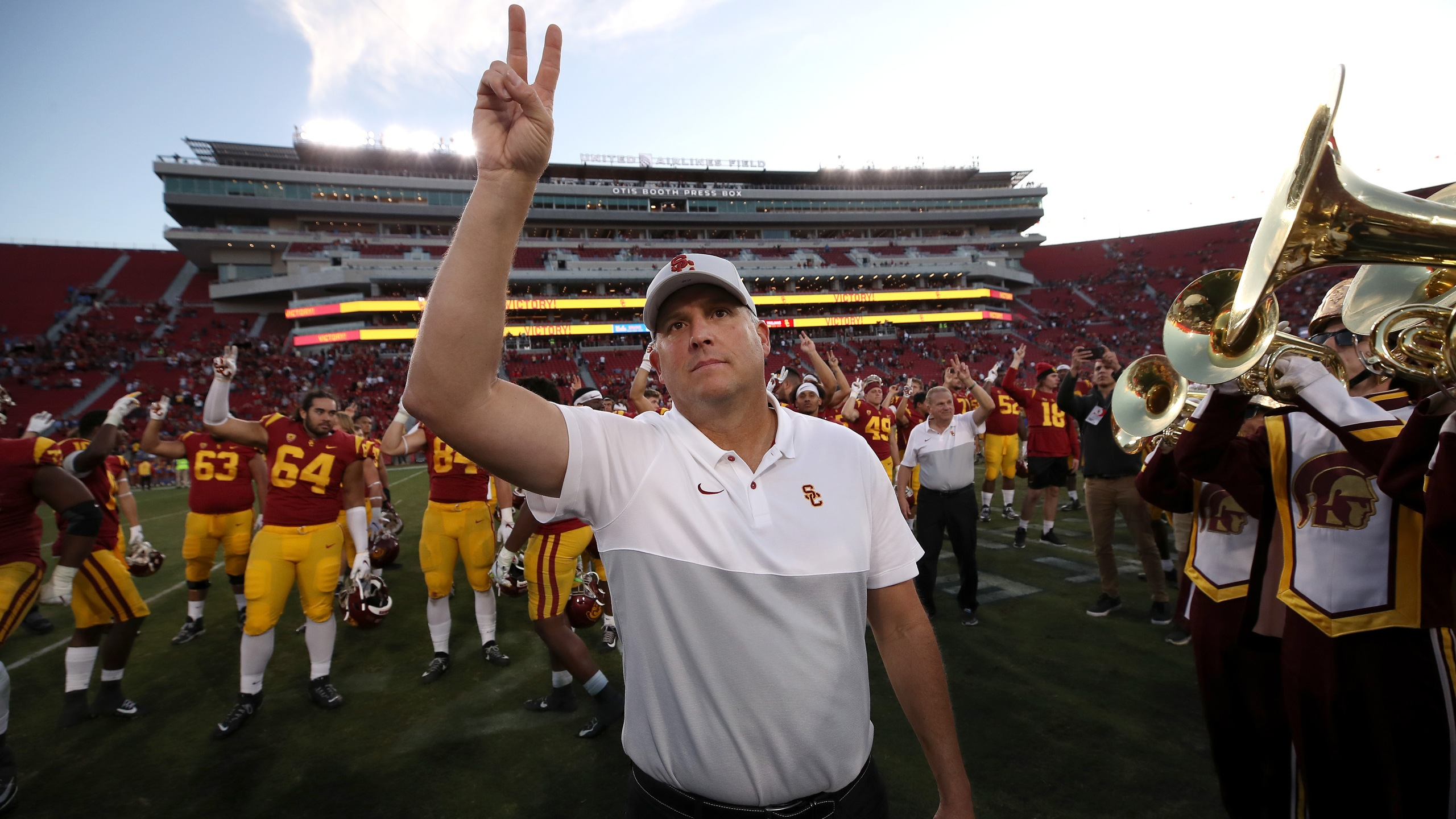 USC Trojans head coach Clay Helton waves to fans after defeating the UCLA Bruins 52-35 at Los Angeles Memorial Coliseum on Nov. 23, 2019. (Credit: Sean M. Haffey / Getty Images)