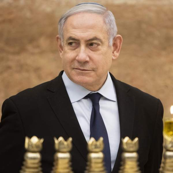 Israeli Prime Minister Benjamin Netanyahu looks on after lighting a Hanukkah candle at the Western Wall, Judaism's holiest prayer site, in the Old City of Jerusalem on Dec. 22, 2019. (Credit: SEBASTIAN SCHEINER/POOL/AFP via Getty Images)