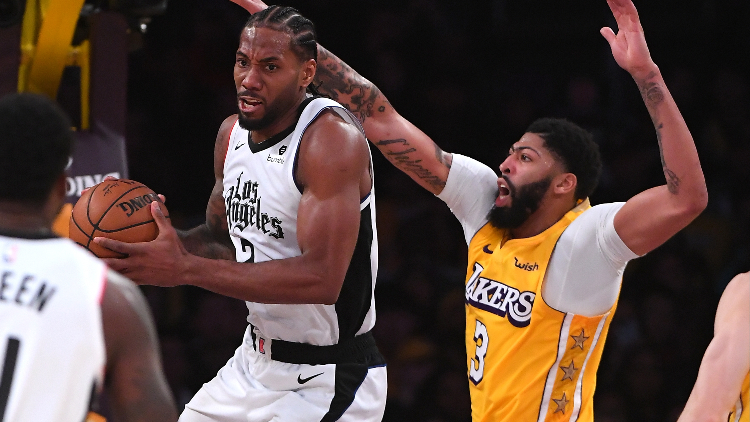 Anthony Davis #3 of the Los Angeles Lakers defends guards Kawhi Leonard #2 of the Los Angeles Clippers as he makes a pass under the basket in the second half of the game at Staples Center on Dec. 25, 2019. (Credit: Jayne Kamin-Oncea/Getty Images)
