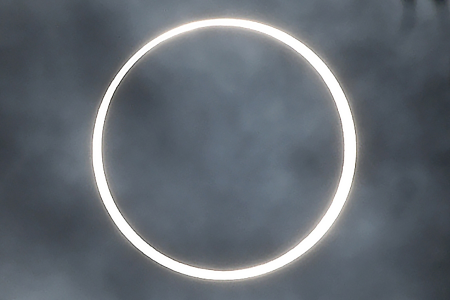 """The moon totally covers the sun in a rare """"ring of fire"""" solar eclipse as seen from the south Indian city of Dindigul in Tamil Nadu state on Dec. 26, 2019. (Credit: ARUN SANKAR/AFP via Getty Images)"""