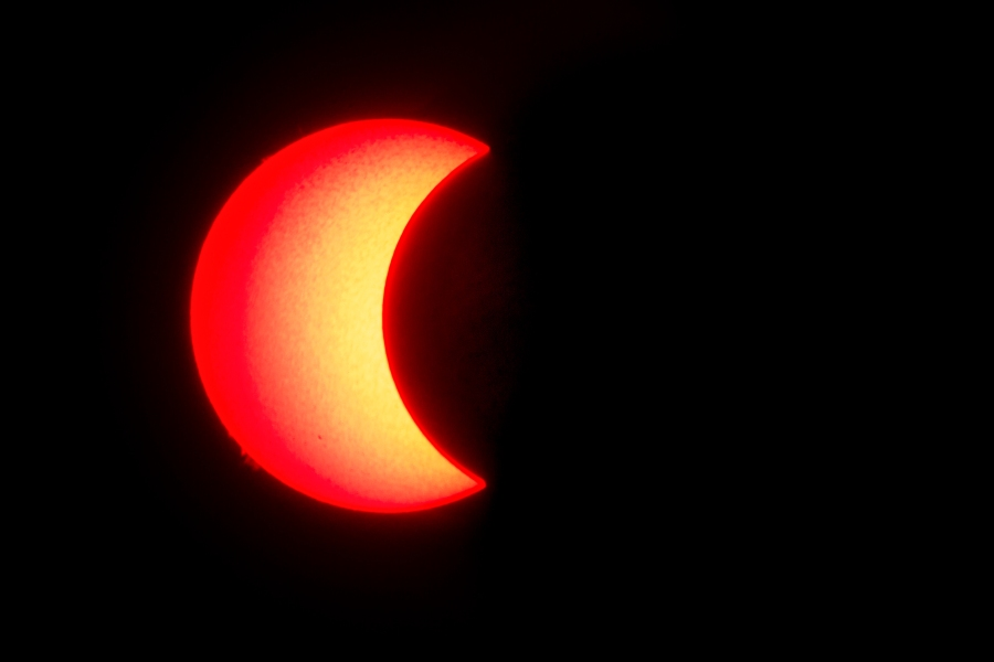 """The surface of the sun is seen as the moon moves in front of it in a rare """"ring of fire"""" solar eclipse, as seen from Wan Twin in central Myanmar on Dec. 26, 2019. (Credit: YE AUNG THU/AFP via Getty Images)"""
