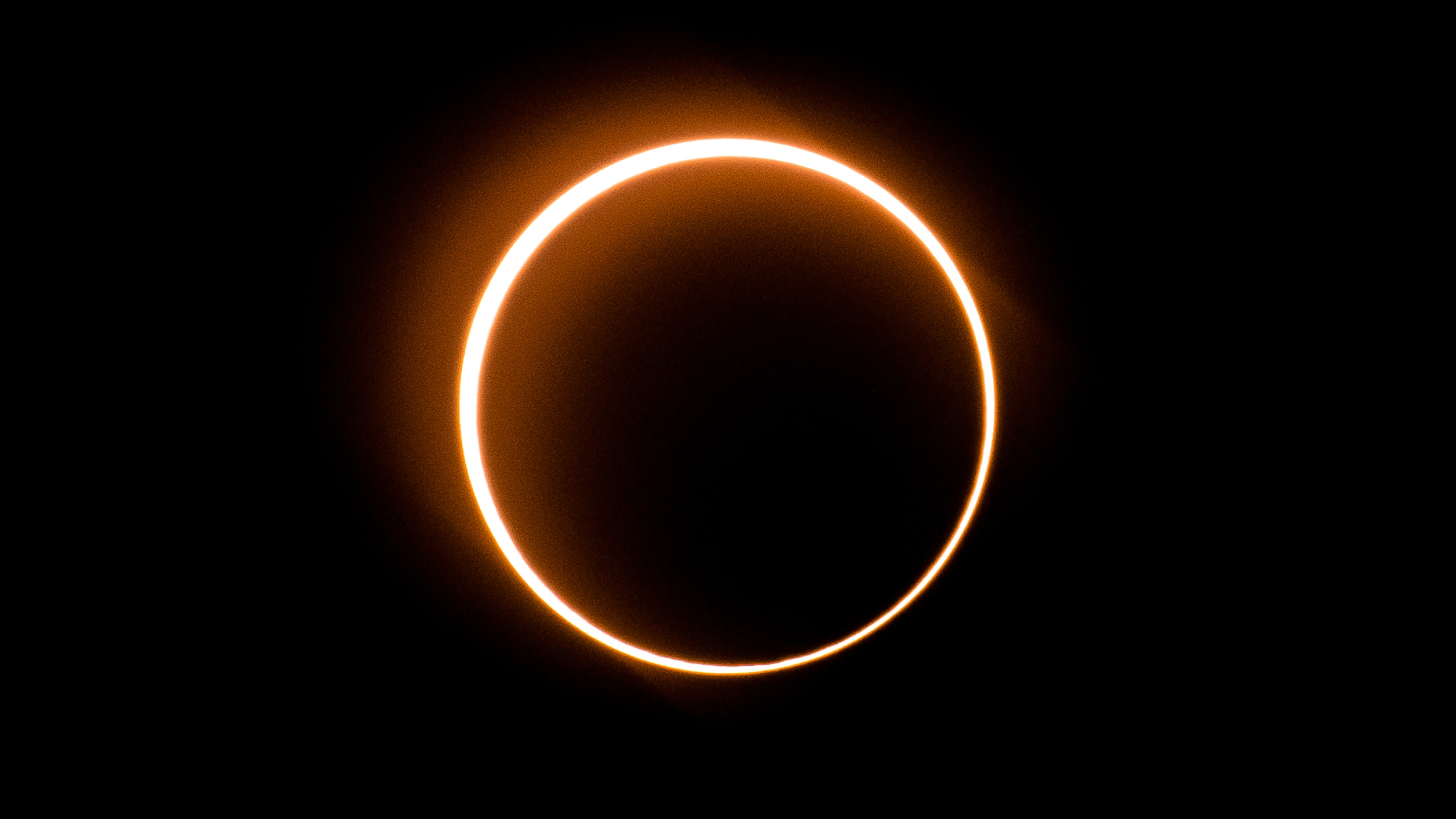 """The moon moves in front of the sun in a rare """"ring of fire"""" solar eclipse as seen from Tanjung Piai, Malaysia on December 26, 2019. (Credit: SADIQ ASYRAF/AFP via Getty Images)"""