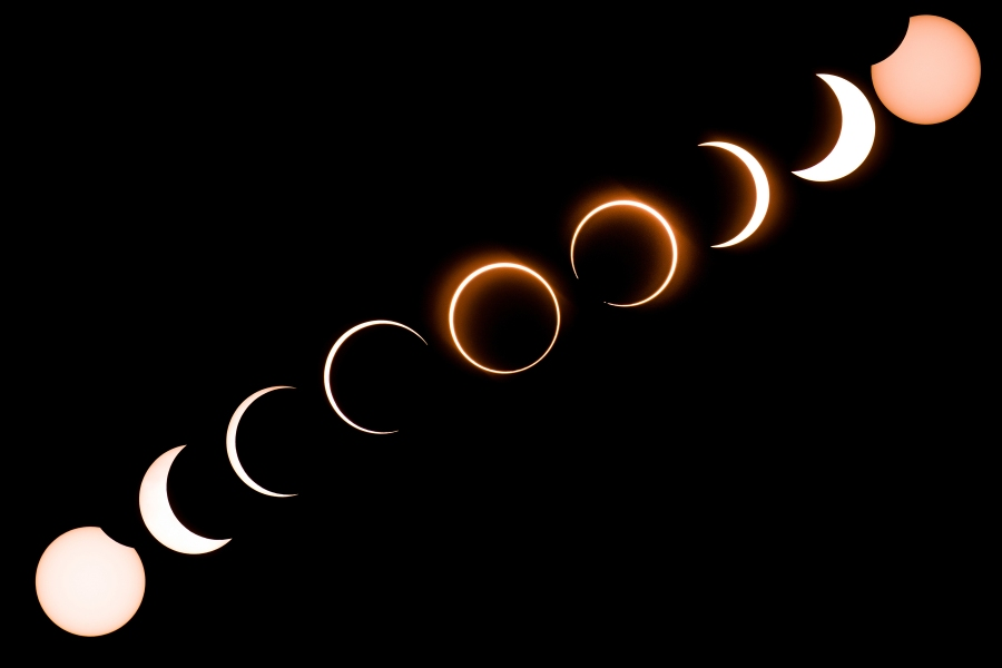 """This composite image shows the moon as it moves in front of the sun in a rare """"ring of fire"""" solar eclipse as seen from Tanjung Piai in Malaysia on December 26, 2019. (Credit: SADIQ ASYRAF/AFP via Getty Images)"""