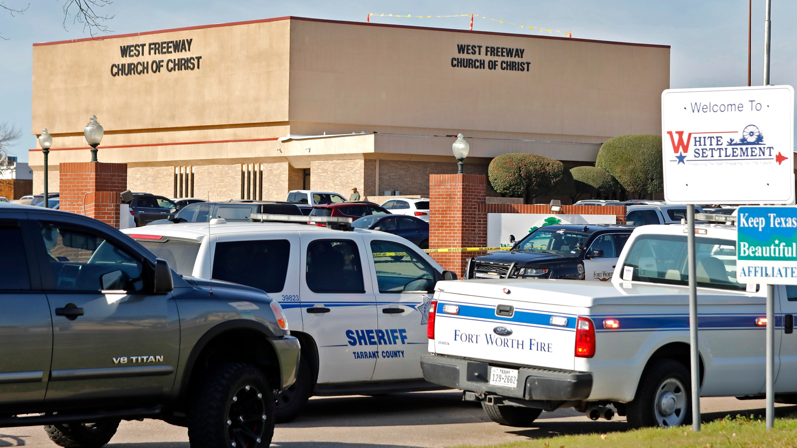 Law enforcement vehicles are parked outside West Freeway Church of Christ where a shooting took place at the morning service on Dec. 29, 2019, in White Settlement, Texas. (Credit: Stewart F. House/Getty Images)