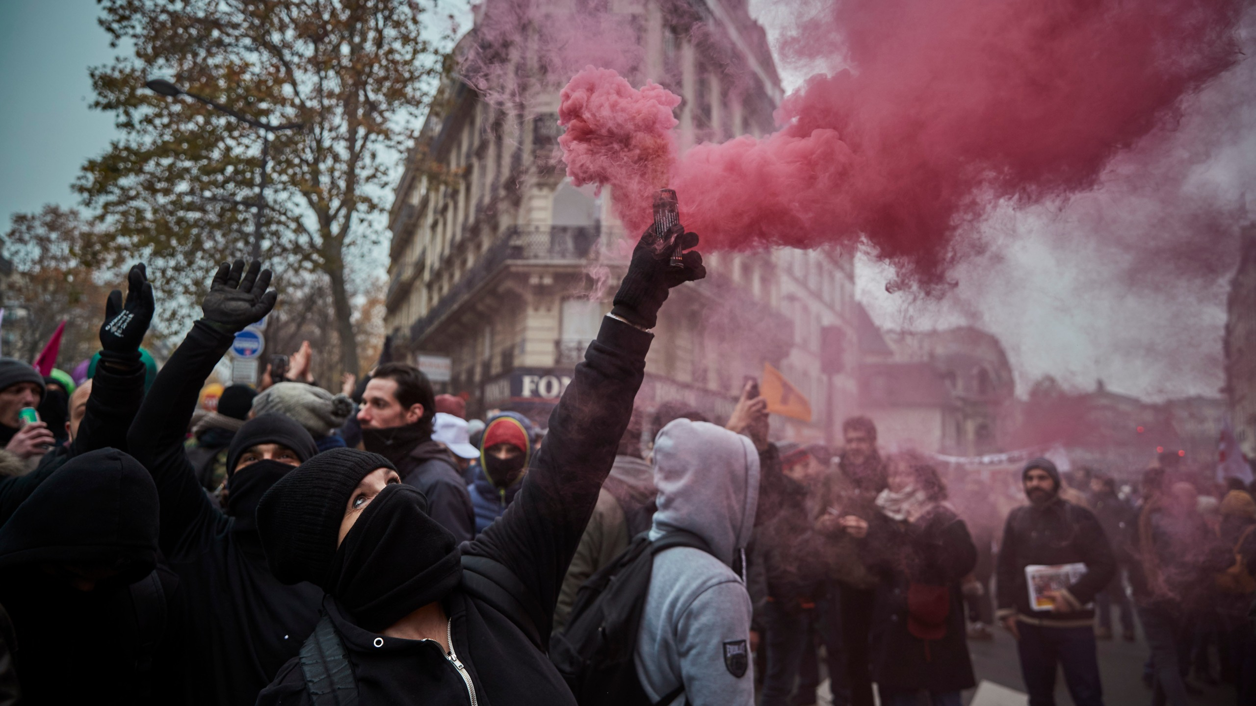 Protestors wave colored flares during a rally near Place de Republique in support of the national strike in France, one of the largest nationwide strikes in years, on Dec. 5, 2019 in Paris, France. (Credit: Kiran Ridley/Getty Images)