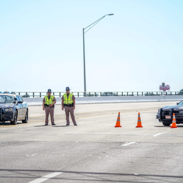 Florida State Troopers block traffic over the Bayou Grande Bridge leading to the Pensacola Naval Air Station following a shooting on Dec. 6, 2019 in Pensacola. (Josh Brasted/Getty Images)