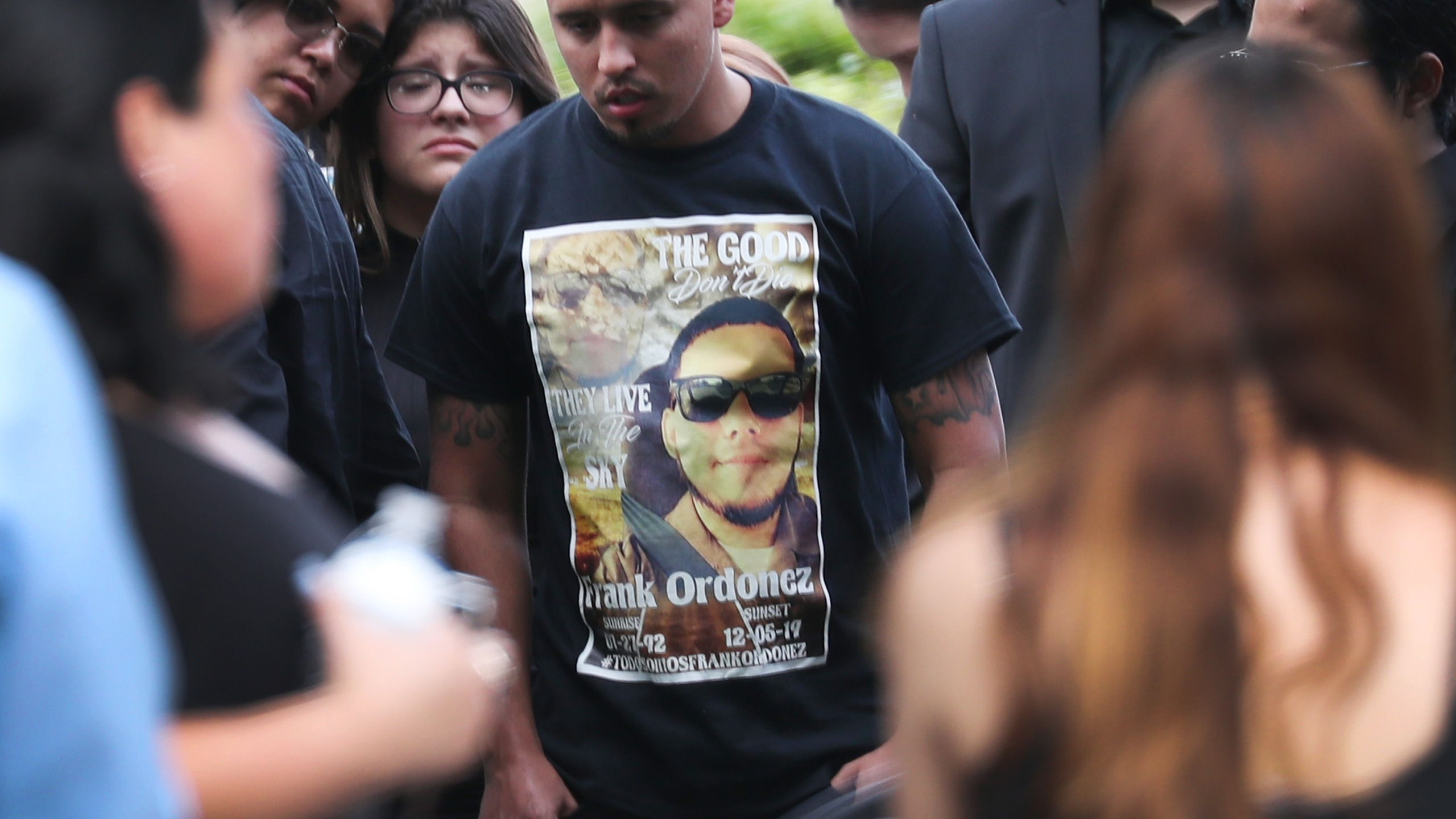 Mourners gather as Frank Ordonez, the UPS driver killed during a shootout between police and two armed robbery suspects, is laid to rest at the Vista Memorial Gardens cemetery on December 10, 2019 in Miami Lakes, Florida. (Credit: Joe Raedle/Getty Images)