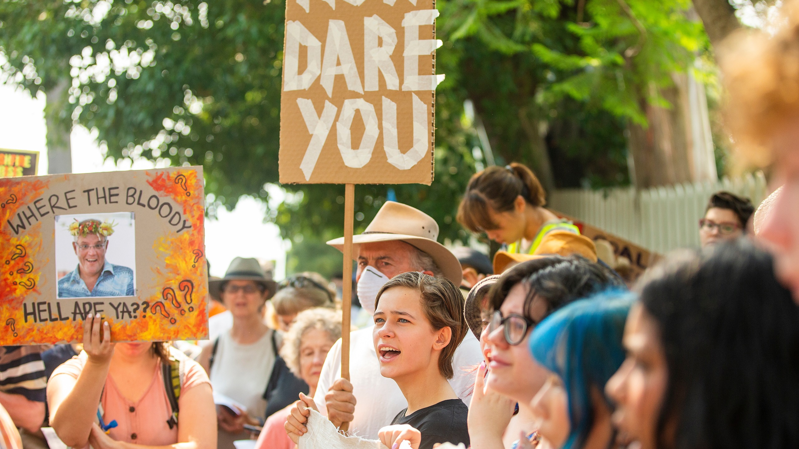 Protestors hold up banners during a protest at Kirribilli House on Dec. 19, 2019 in Sydney, Australia. Protestors organized the rally outside Prime Minister Scott Morrison's Sydney residence over his absence during the ongoing bushfire emergencies across Australia. (Credit: Jenny Evans/Getty Images)