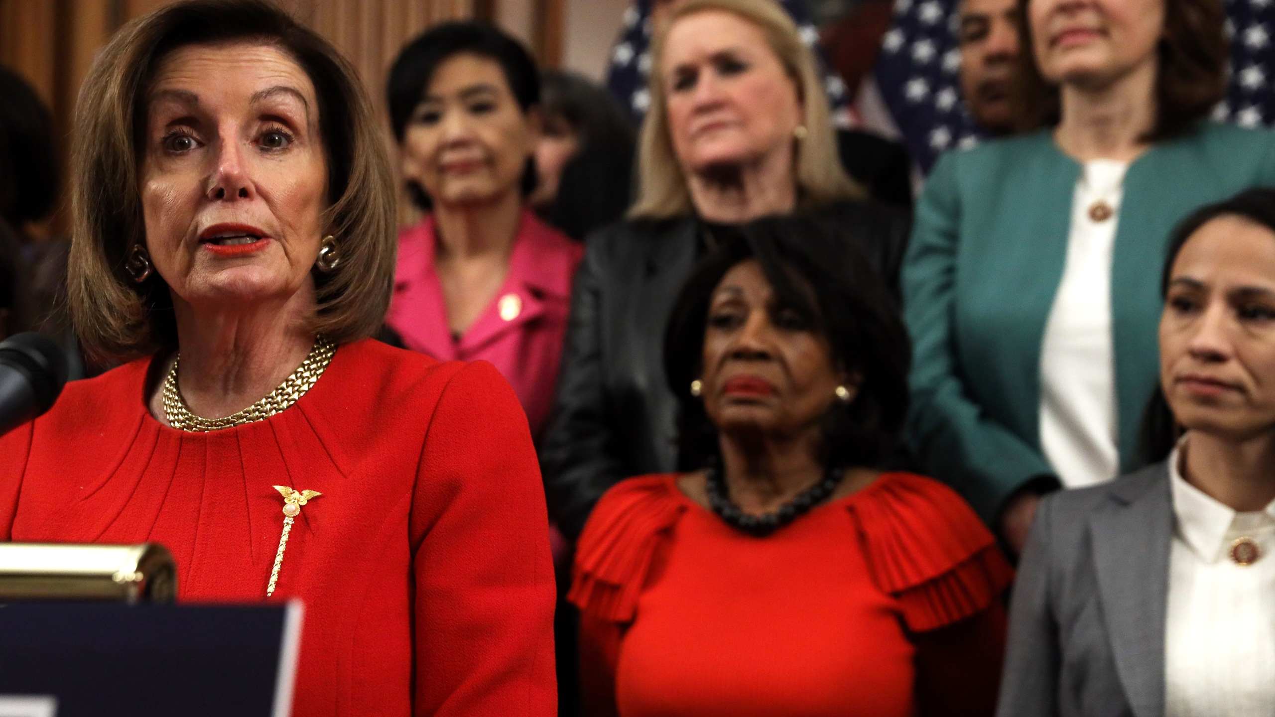 U.S. Speaker of the House Rep. Nancy Pelosi (D-CA) speaks as other House Democrats look on during an event at the Rayburn Room of the U.S. Capitol Dec. 19, 2019, in Washington, D.C. (Credit: Alex Wong/Getty Images)