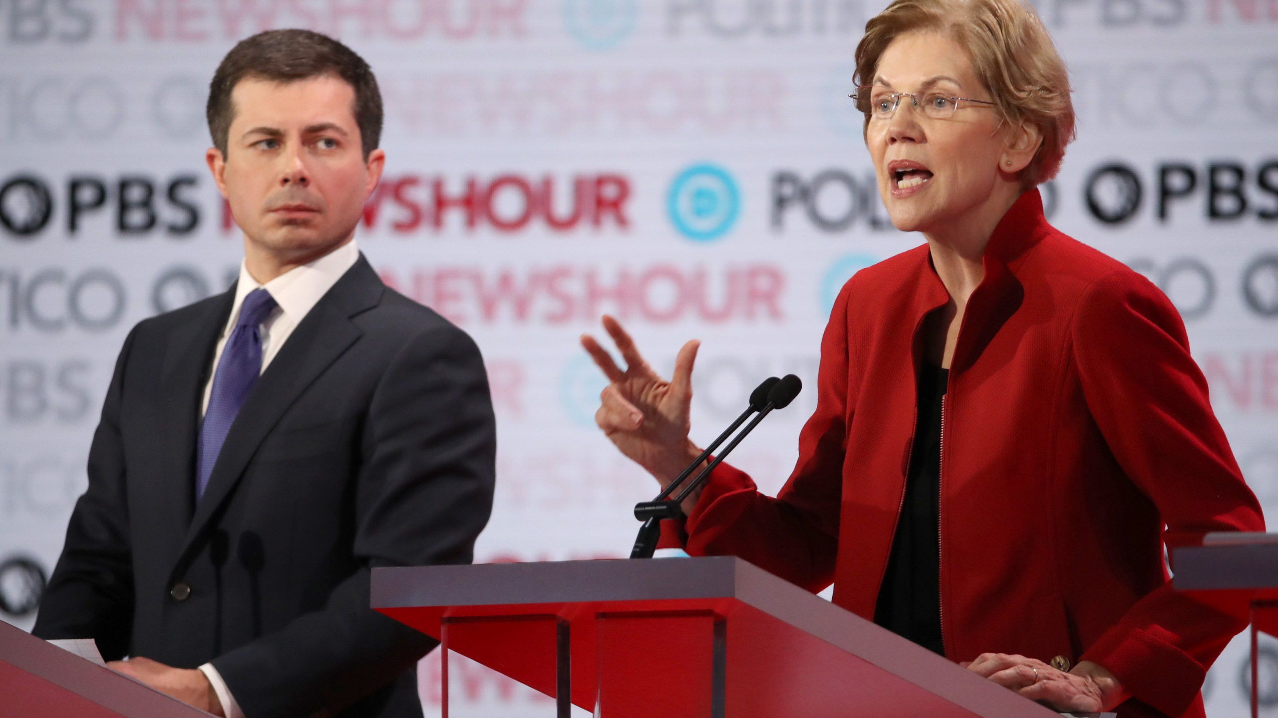 Sen. Elizabeth Warren (D-MA) speaks as South Bend, Indiana Mayor Pete Buttigieg listens during the Democratic presidential primary debate at Loyola Marymount University on Dec. 19, 2019. (Credit: Justin Sullivan/Getty Images)