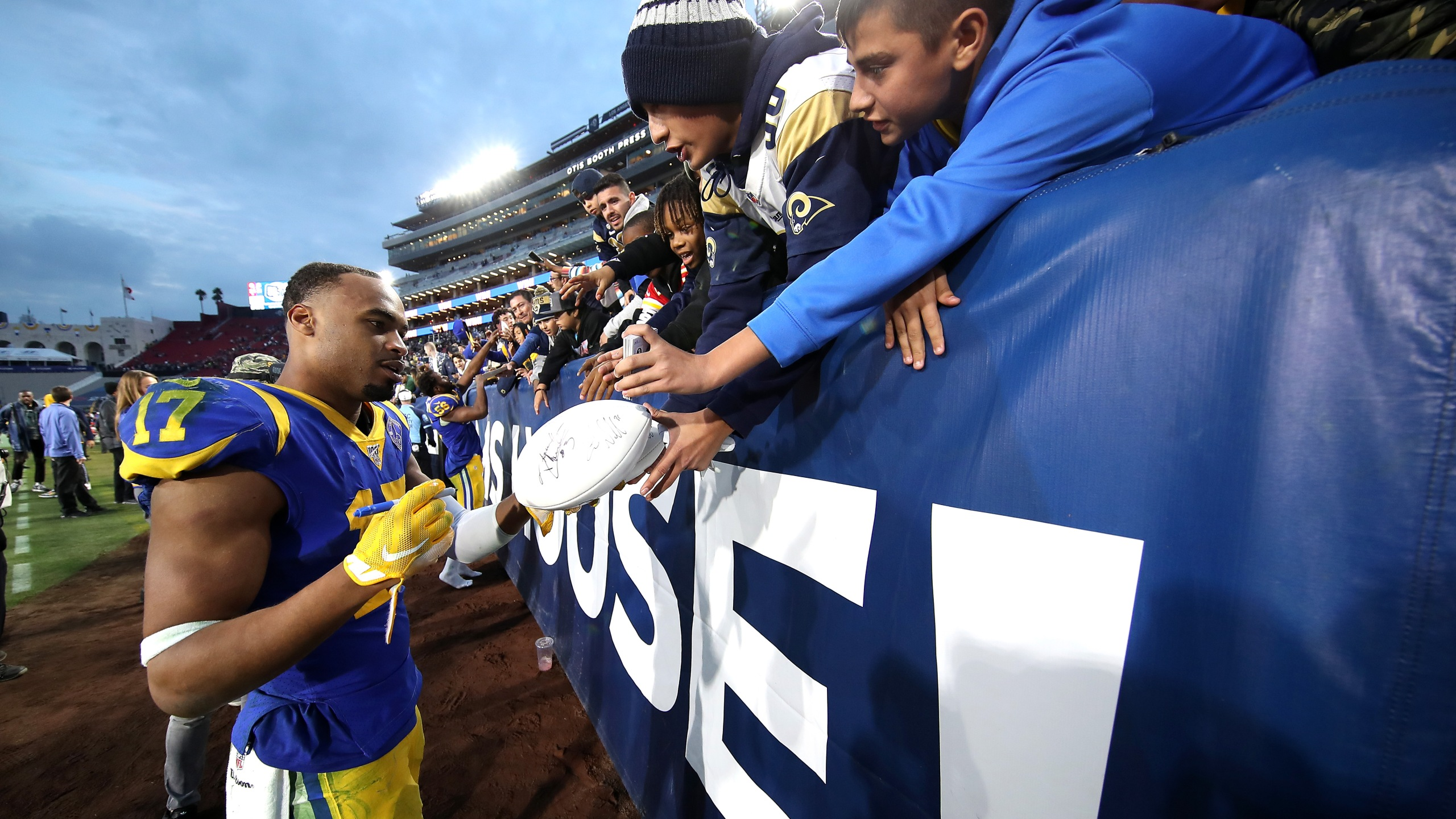 Robert Woods of the Los Angeles Rams signs autographs for fans after a game against the Arizona Cardinals at Los Angeles Memorial Coliseum on Dec. 29, 2019. (Credit: Sean M. Haffey/Getty Images)