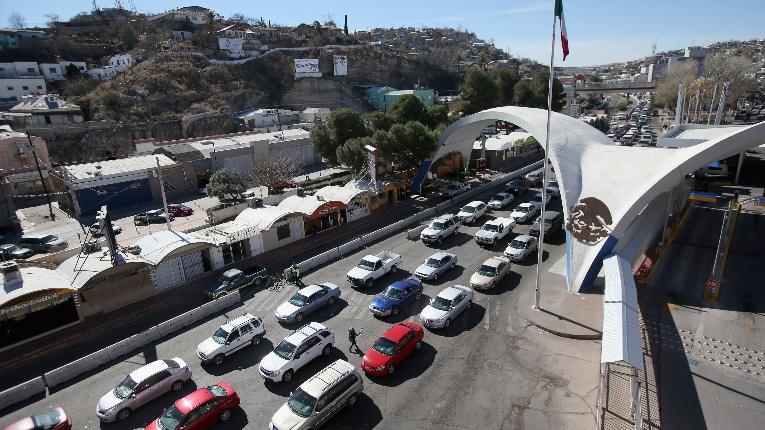 In this Feb. 26, 2013, file photo, traffic from Mexico waits to cross into Nogales, Arizona. (Credit: John Moore / Getty Images)