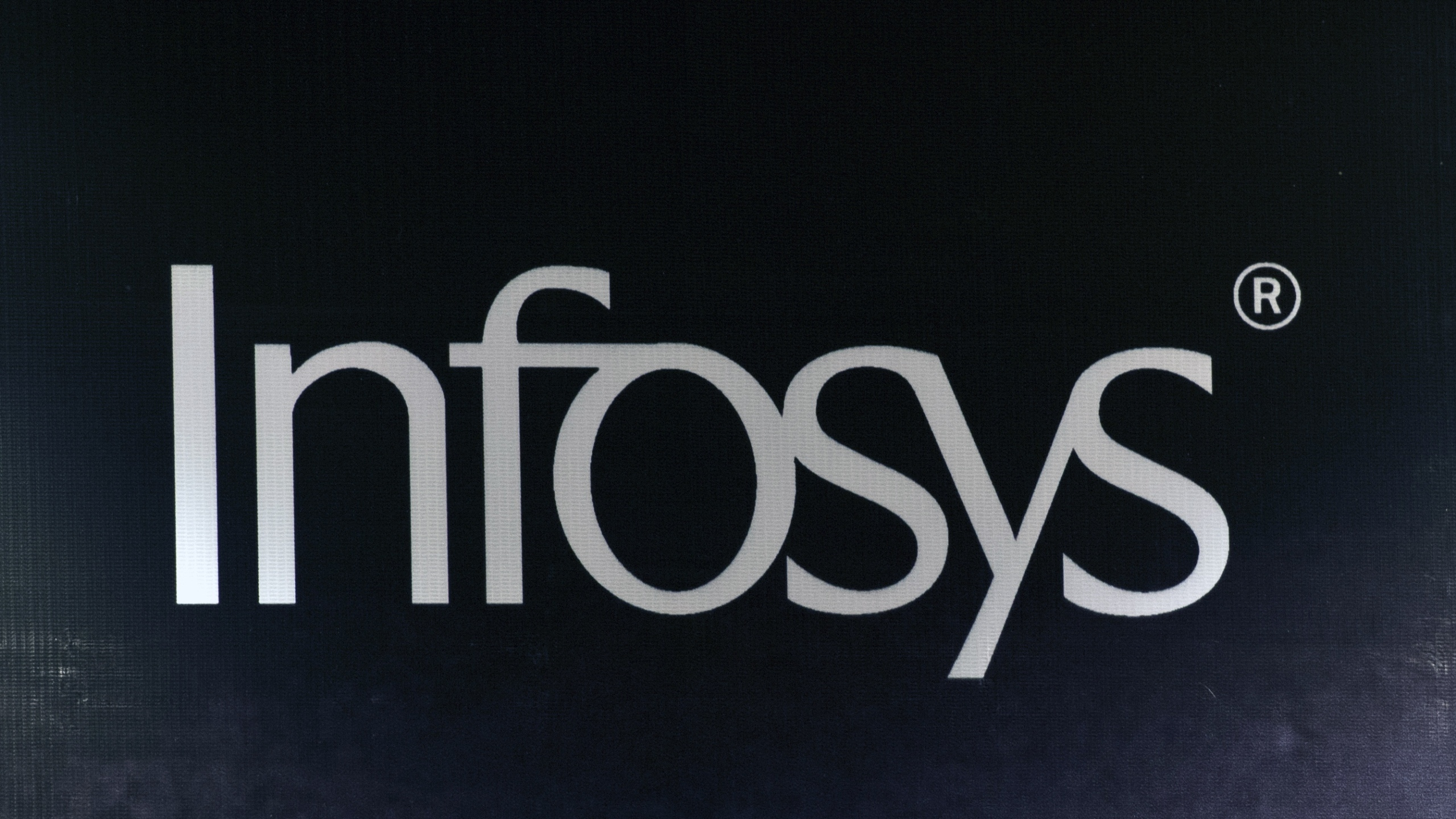 The company logo for Infosys is pictured in New Delhi on April 16, 2013. (Credit: PRAKASH SINGH/AFP via Getty Images)
