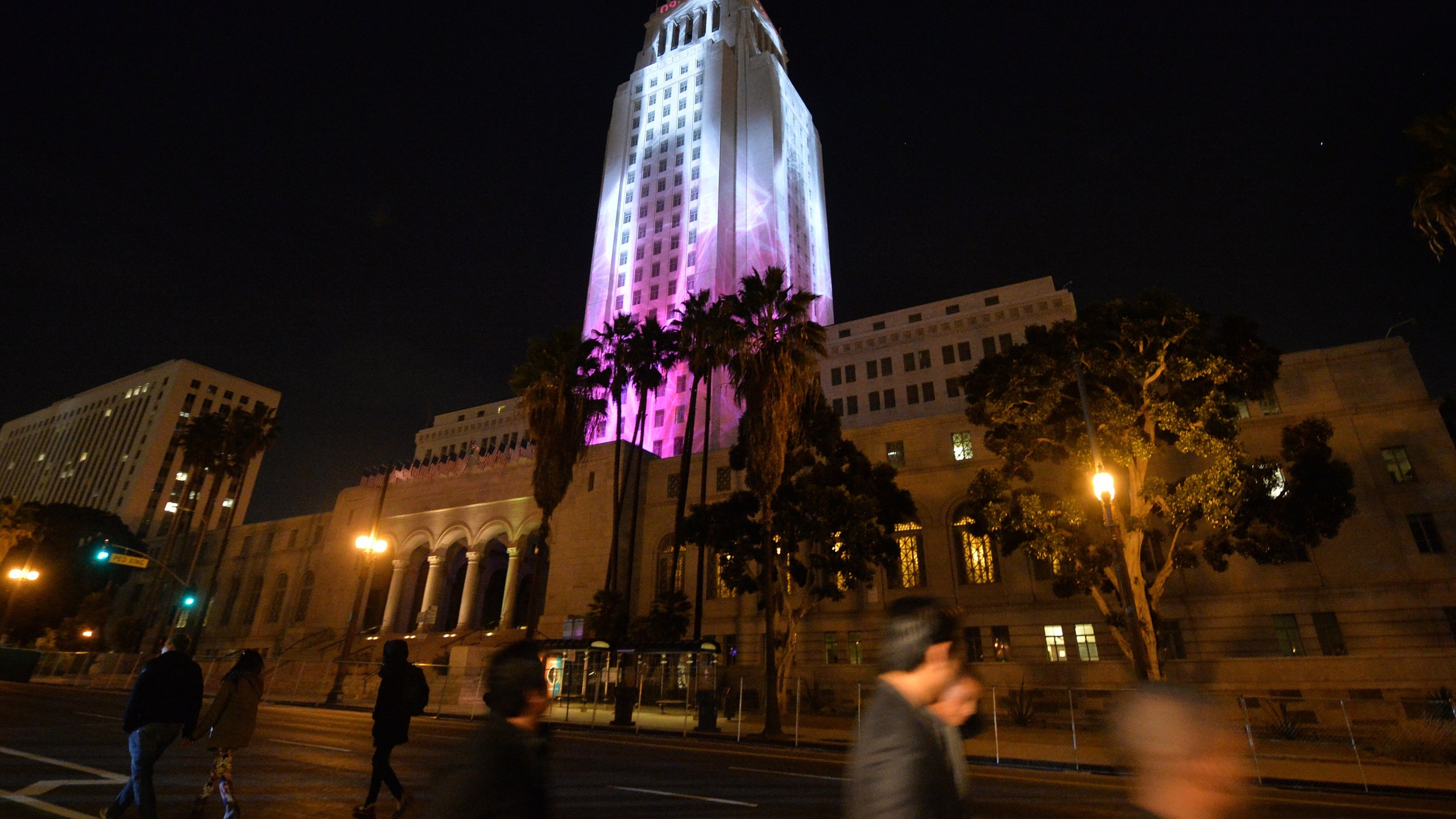 City Hall is lit by two dimensional projected images while people celebrate the New Year at the Grand Park's N.Y.E.L.A. event in downtown Los Angeles on December 31, 2014. (Credit: MARK RALSTON/AFP via Getty Images)