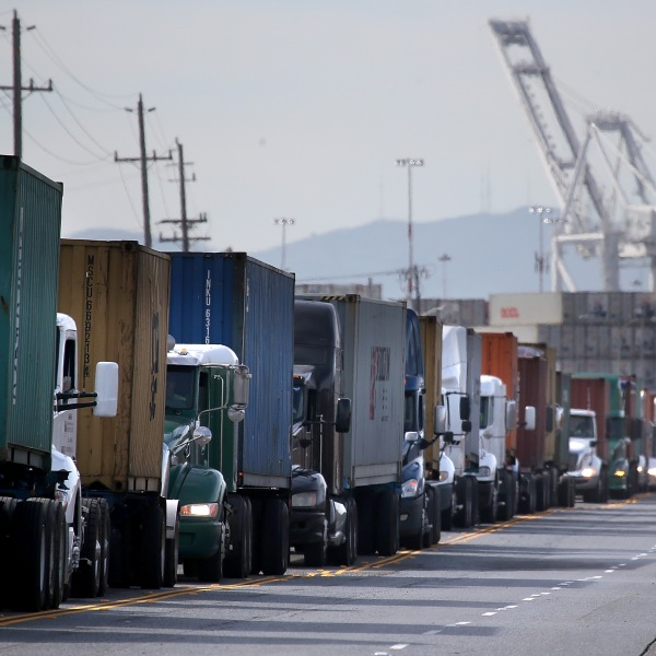 Trucks line up to enter a berth at the Port of Oakland on Feb. 11, 2015. (Credit: Justin Sullivan / Getty Images)